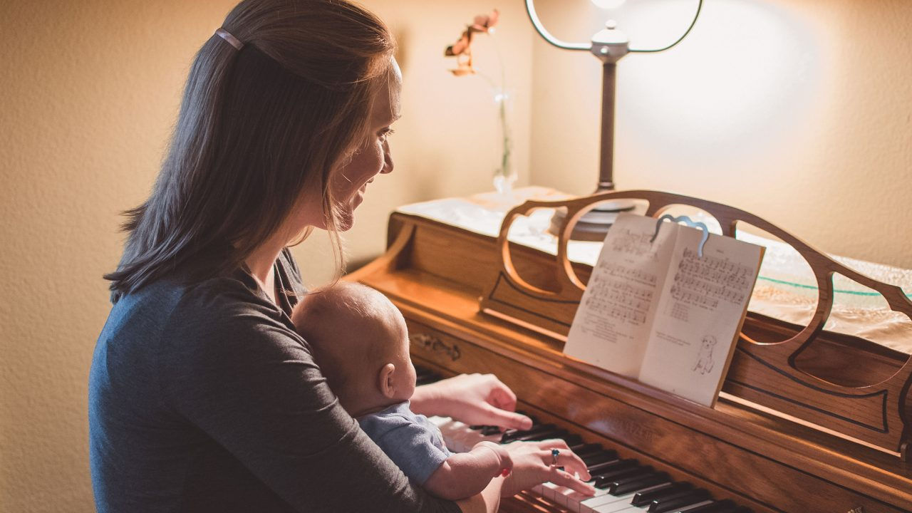 Activity time with mom and baby playing piano